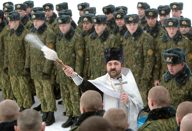 . An Orthodox priest blesses servicemen of the Belarussian Interior Ministry\'s special unit during a service at a military base in Minsk January 7, 2013. Most Orthodox Christians celebrate Christmas according to the Julian calendar on January 7, two weeks after most western Christian churches that abide by the Gregorian calendar.  REUTERS/Vasily Fedosenko