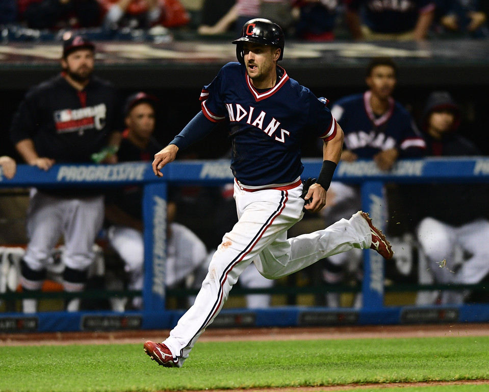 . Cleveland Indians\' Lonnie Chisenhall runs home to score a run on a RBI single by Rajai Davis in the sixth inning of a baseball game against the Kansas City Royals, Saturday, June 4, 2016, in Cleveland, Ohio. (AP Photo/David Dermer)