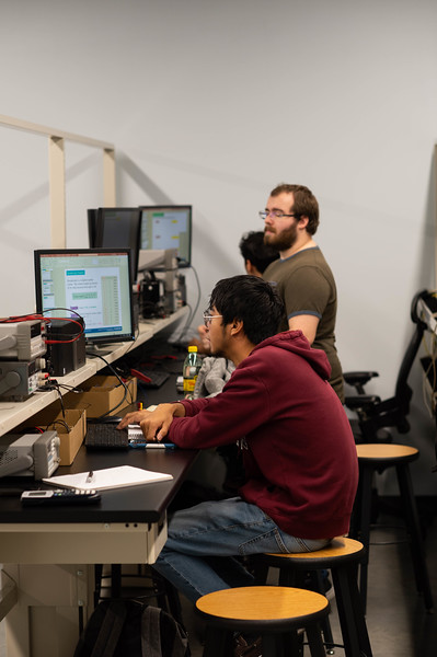 Caleb Flowers (Green Shirt) and Matthew Zuniga attentively listening to lecture in the Engineering Labs