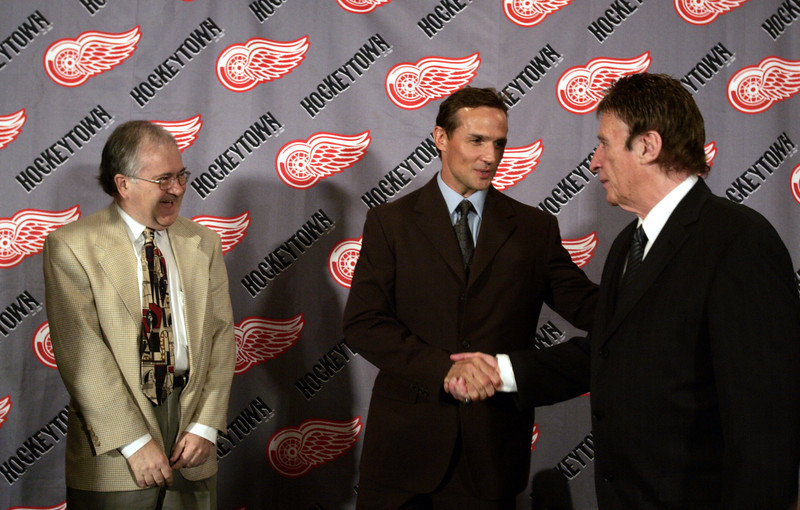 . Detroit Red Wings captain Steve Yzerman, center, shakes hands with team owner Mike Ilitch as team general manager Jim Devellano looks on after a news conference in Detroit, Monday, July 3, 2006, where Yzerman announced his retirement from hockey. Yzerman played for 23 seasons and played in 1,514 games, scored 692 goals, and tallied 1,063 assists. (AP Photo/Carlos Osorio)