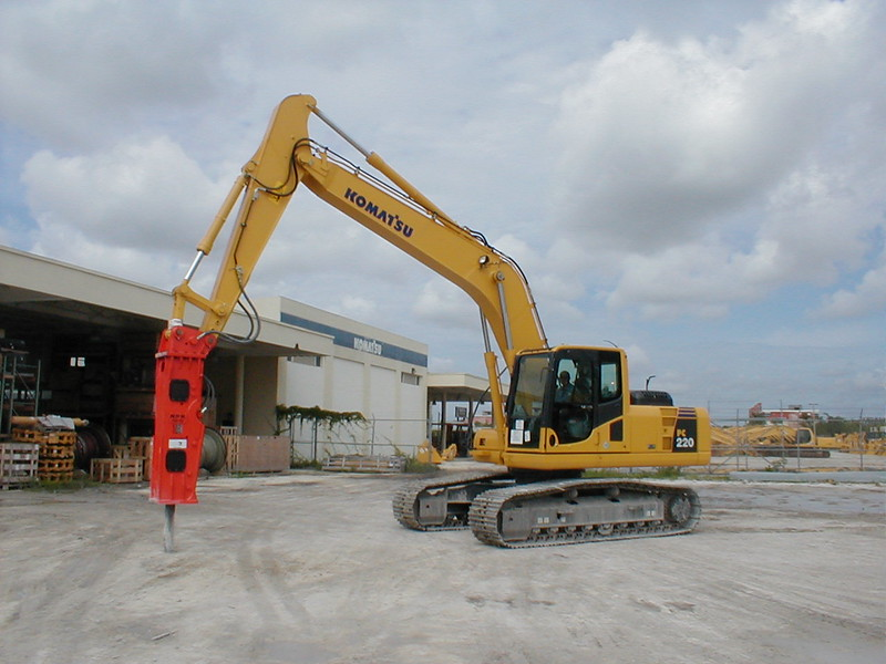 NPK E213 hydraulic hammer on Komatsu excavator.jpg