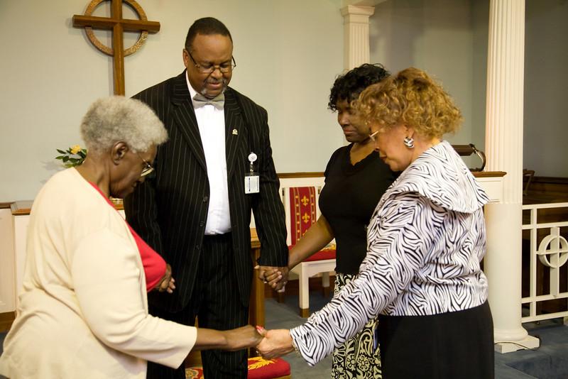 Quick prayer session in the chapel. Bernice J. Miller, Chaplain Burns, Linda Mendinghall, Denise D. Cathey