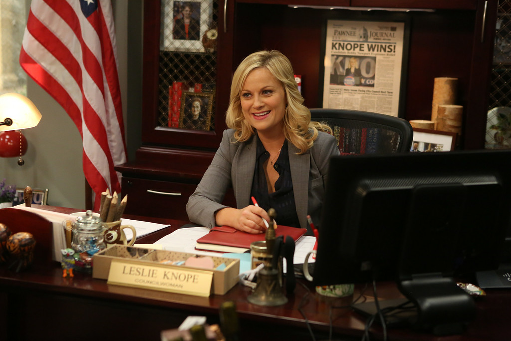 """. This image released by NBC shows Amy Poehler in a scene from \""""Parks & Recreation.\"""" Poehler was nominated for an Emmy Award for best actress in a comedy series on Thursday, July 10, 2014. The 66th Primetime Emmy Awards will be presented Aug. 25 at the Nokia Theatre in Los Angeles. (AP Photo/NBC, Dean Hendler)"""
