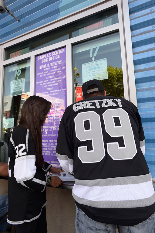 . Fans wait at the ticket window before they enter Staples Center before the Los Angeles Kings faced the New York Rangers in game 1 of the Stanley Cup Finals. Los Angeles, CA. 6/4/2014(Photo by John McCoy / Los Angeles Daily News)