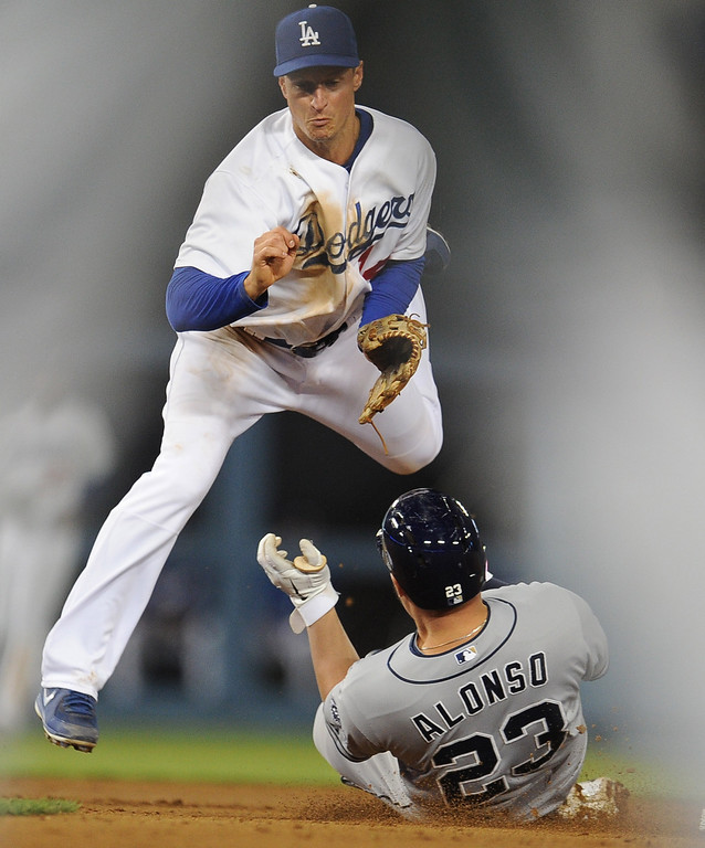 . Los Angeles Dodgers second baseman Mark Ellis forces out San Diego Padres\' Yonder Alonso (23) in the fourth inning of their baseball game on Wednesday, April 17, 2013 in Los Angeles.   (Keith Birmingham/Pasadena Star-News)