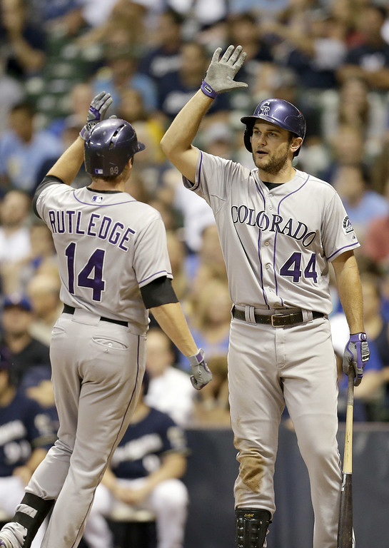. MILWAUKEE, WI - JUNE 27: Josh Rutledge #14 of the Colorado Rockies celebrates with Ryan Wheeler #44 after hitting a solo home run in the top of the ninth inning against the Milwaukee Brewers at Miller Park on June 27, 2014 in Milwaukee, Wisconsin. (Photo by Mike McGinnis/Getty Images)