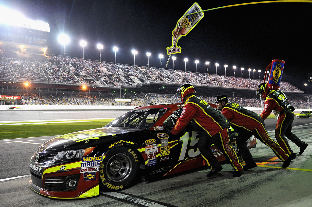 . Clint Bowyer, driver of the #15 5-hour ENERGY Toyota, pits during the NASCAR Sprint Cup Series Budweiser Duel 2 at Daytona International Speedway on February 20, 2014 in Daytona Beach, Florida.  (Photo by Patrick Smith/Getty Images)