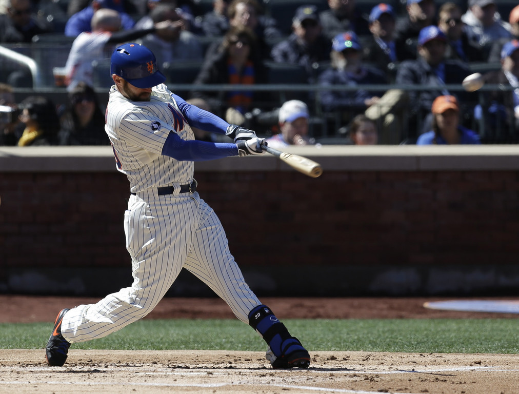 . New York Mets\' Andrew Brown hits a three-run homer during the first inning of a baseball game against the Washington Nationals on opening day at Citi Field in New York, Monday, March 31, 2014.  (AP Photo/Seth Wenig)