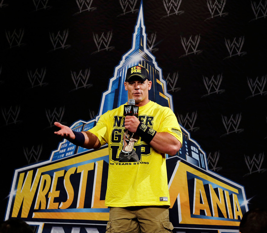 . John Cena answers a question during a news conference before the WWE Wrestlemania 29 wrestling event, Sunday, April 7, 2013, in East Rutherford, N.J. (AP Photo/Mel Evans)