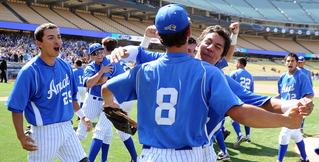 . Bishop Amat pitcher Scott Hurst (8) celebrates with teammates after recording the final out and defeating Palm Desert 4-3 to win the CIF-SS Division 3 baseball championship at Dodger Stadium in Los Angeles on Friday, June 6, 2014. 