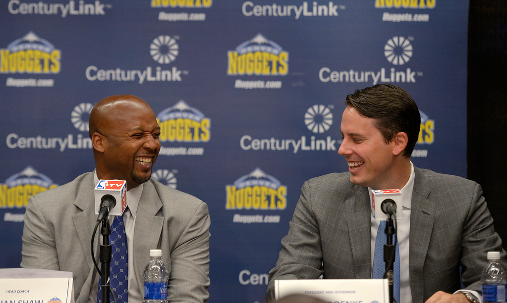 . The Denver Nuggets President Josh Kroenke shares a laugh with new head coach Brian Shaw as they address the media June 25, 2013 during a press conference  at Pepsi Center. (Photo By John Leyba/The Denver Post)