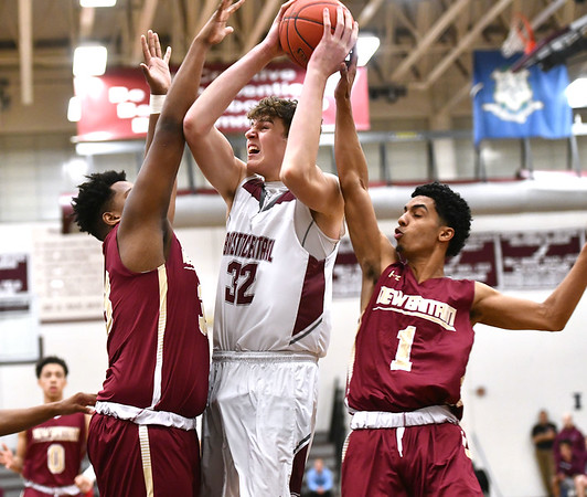 1/3/2020 Mike Orazzi | StaffrBristol Central High School's Donovan Clingan (32) and New Britain's Dontay Bishop (33) and Edgar Torres (1) during Friday night's boys basketball game in Bristol.