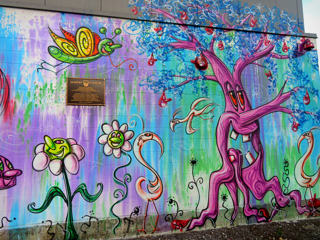 kenny scharf mural in the bronx on the side of Krinos food - tree and flowers