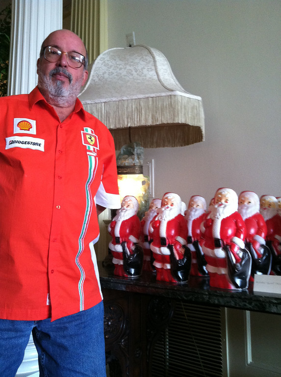. Artist Phil Bender with the multiple-Santa piece he brought to the Governor\'s Residence at Boettcher Mansion. Photo by Elana Ashanti Jefferson, Special to The Denver Post