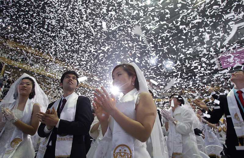 . Couples take part in a mass wedding ceremony at Cheongshim Peace World Center on February 12, 2014 in Gapyeong-gun, South Korea. 2,500 couples from around the world exchanged wedding vows in the wedding the Unification Church claims as one of its largest ever.  (Photo by Chung Sung-Jun/Getty Images)