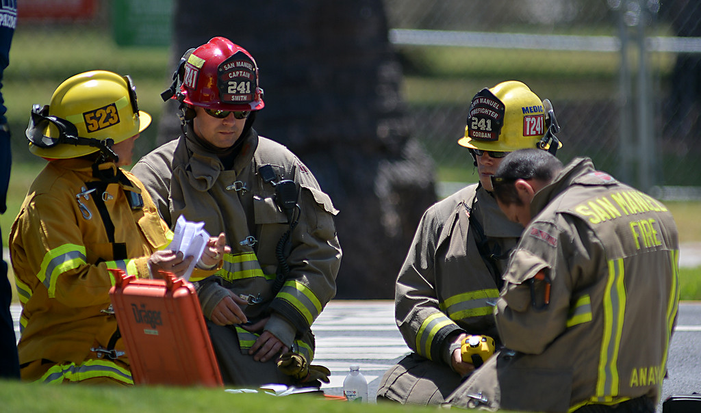 . Firefighters from Redlands, San Bernardino County and San Manuel responded to the area of Cajon Street and E Cypress Avenue after a Verizon crew working in an underground vault reported a possible gas leak. Voluntary evacuations were in affect for homes and businesses facing Cajon Street between Olive and Highland avenues due to possible flammable gas. (Photo by Rick Sforza/Redlands Daily Facts)