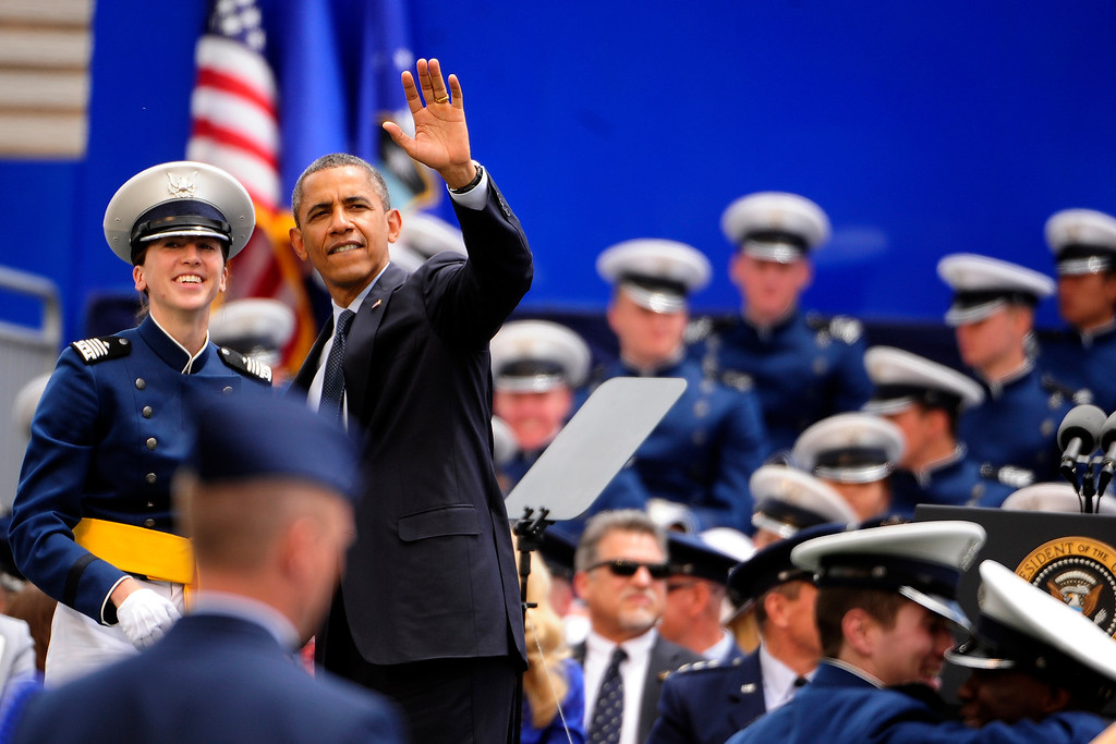 . President Barack Obama waves to a cadet\'s supporters during the commencement ceremony at the United States Air Force Academy in Colorado Springs on Wednesday, May 23, 2012. AAron Ontiveroz, The Denver Post