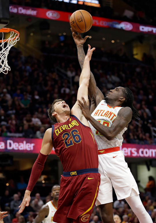 . Atlanta Hawks\' Taurean Prince (12) drives to the basket against Cleveland Cavaliers\' Kyle Korver (26) in the first half of an NBA basketball game, Sunday, Nov. 5, 2017, in Cleveland. (AP Photo/Tony Dejak)