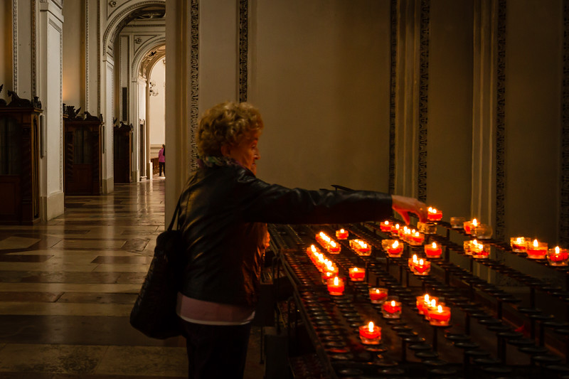 Genevieve Hathaway_Austria_Salzburg_Salzburg Cathedral_lighting candles.jpg