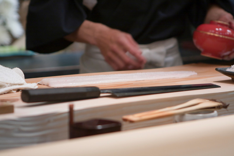 Hiro preparing hama fish (white fish).  This is used later in the shabu shabu.