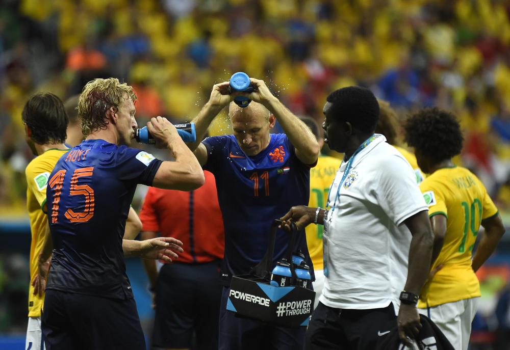 . Netherlands\' defender Dirk Kuyt (L) and Netherlands\' forward Arjen Robben refresh with water during the third place play-off football match between Brazil and Netherlands during the 2014 FIFA World Cup at the National Stadium in Brasilia on July 12, 2014. (ODD ANDERSEN/AFP/Getty Images)