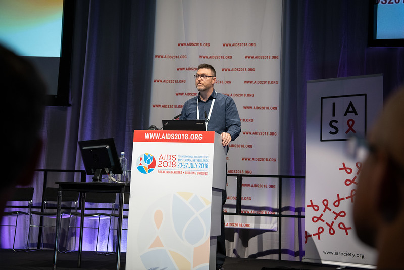 22nd International AIDS Conference (AIDS 2018) Amsterdam, Netherlands.   Copyright: Steve Forrest/Workers' Photos/ IAS  Photo shows: Aaron Cogle, delivering a speech in memory of David Cooper, during the IAS Members' Meeting.