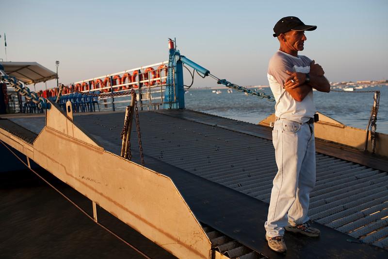 Sailor of the barge for crossing the Guadalquivir river. Bajo de Guia beach, town of Sanlucar de Barrameda, province of Cadiz, Andalusia, Spain.