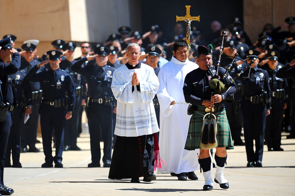 . A funeral for LAPD Officer Roberto Sanchez was held at the Cathedral of Our Lady of the Angels in Los Angeles, CA May 14, 2014.  Sanchez was killed in a hit-and-run crash involving a SUV driver who is accused of deliberately ramming the officer\'s patrol car in Harbor City.(Andy Holzman/LA Daily News)