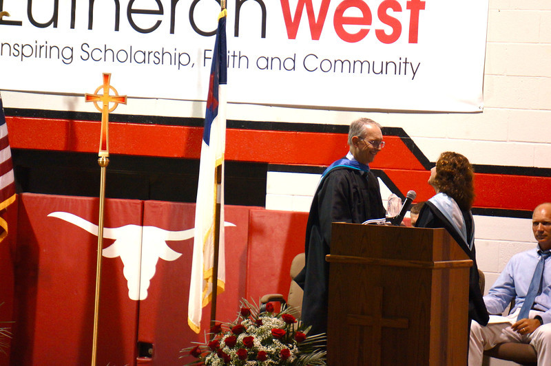 Lutheran West Graduation - Class of 2013  LEADS Award being presented to faculty member Lynn Pangrace by Principal Dale Wolfgram