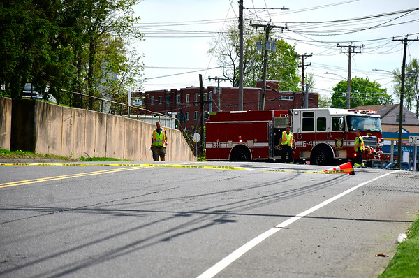 5/7/2019 Mike Orazzi | Staff Bristol firefighters on scene after a truck took down some power lines on Emmett Street Tuesday afternoon knocking out power to a few customers for several hours.