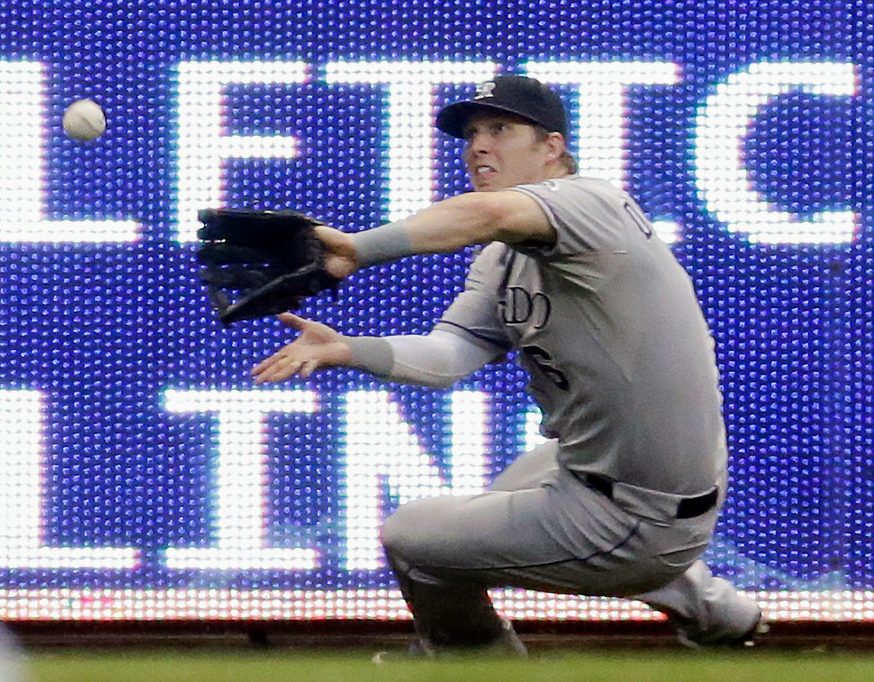 . Colorado Rockies left fielder Corey Dickerson makes a falling catch on a ball hit by Milwaukee Brewers\' Khris Davis during the fourth inning of a baseball game Friday, June 27, 2014, in Milwaukee. (AP Photo/Morry Gash)