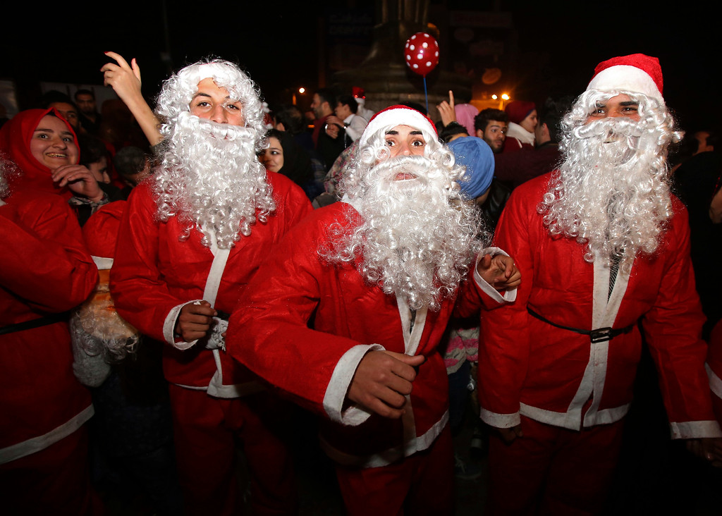 . In this Saturday, Dec. 31, 2016 photo, men dressed as Santa Claus celebrate New Year\'s Eve in Baghdad, Iraq, Iraq, Sunday, Jan. 1, 2017. (AP Photo/ Karim Kadim)