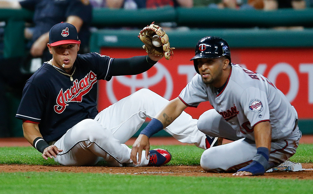 . Minnesota Twins\' Eddie Rosario, right, is out at third base after being tagged out by Cleveland Indians\' Giovanny Urshela as he tried to advance on a fielders choice off the bat of Eduardo Escobar during the fifth inning in a baseball game, Tuesday, Sept. 26, 2017, in Cleveland. (AP Photo/Ron Schwane)