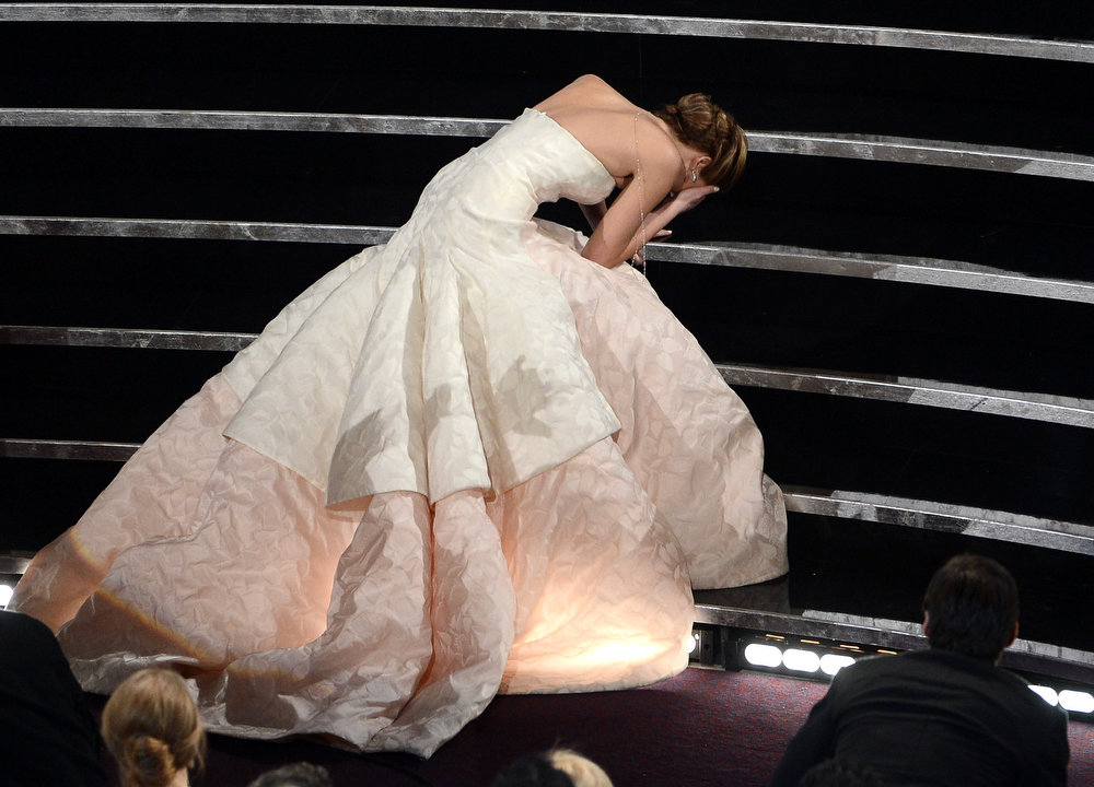 ". Actress Jennifer Lawrence reacts after winning the Best Actress award for ""Silver Linings Playbook\"" during the Oscars held at the Dolby Theatre on February 24, 2013 in Hollywood, California.  (Photo by Kevin Winter/Getty Images)"