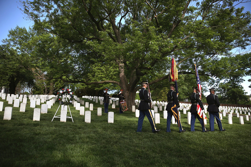. A US Military Honor Guard walks past the grave of Army Pvt. William Christman, after a wreath laying ceremony as part of Arlington at 150 Celebration on May 13, 2014 in Washington, DC.   (Photo by Mark Wilson/Getty Images)