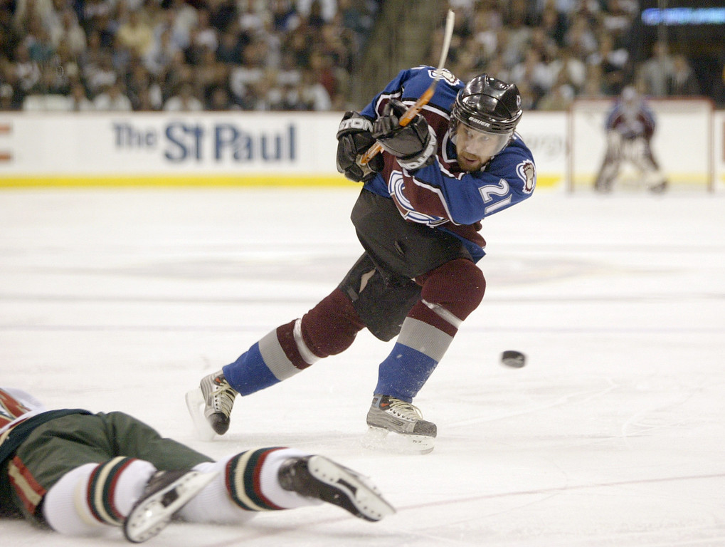 . Peter Forsberg #21 of the Colorado Avalanche watches the puck rebound after Richard Park #18 of the Minnesota Wild lays down to block the shot in the first period during game six of the first round of the NHL playoffs on April 21, 2003 at the Xcel Center in St. Paul, Minnesota. (Photo by Brian Bahr/Getty Images/