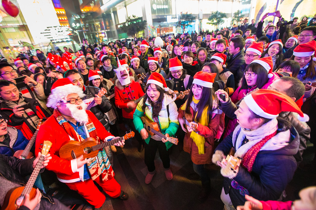 . NANJING, CHINA - DECEMBER 24:  People dressed in Santa Claus costumes attend a celebration for the Christmas Eve at Xinjiekou on December 24, 2013 in Nanjing, China.  (Photo by ChinaFotoPress/Getty Images)