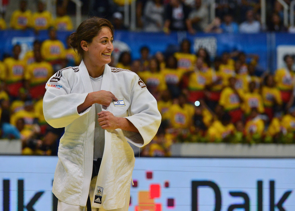 . Israel\'s Yarden Gerbi celebrates after defeating France\'s Clarisse Agbegnenou in the women\'s -63kg category final, during the IJF World Judo Championship, in Rio de Janeiro, Brazil, on August 29, 2013.  YASUYOSHI CHIBA/AFP/Getty Images