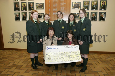 JOanne Lindsey ~SAH recieved a cheque from pupils and Charity Co-ordinator Mrs Bridget McGeeney for £3856.77, proceeds raised through car raffle. 05W51N45