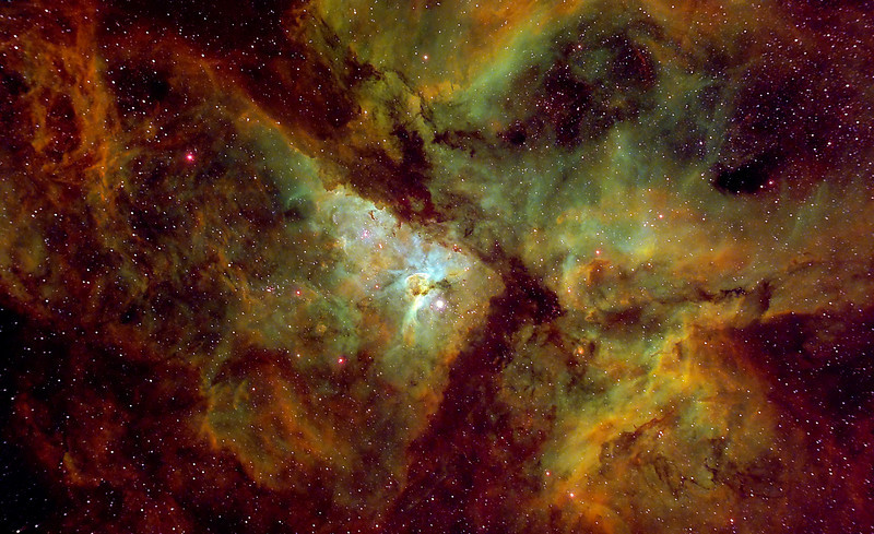 """NGC 3372 aka ETA Carina The Carina Nebula (also known as the Great Nebula in Carina, the Eta Carinae Nebula, or NGC 3372) is a large bright nebula that surrounds several open clusters of stars. Eta Carinae and HD 93129A, two of the most massive and luminous stars in our Milky Way galaxy, are among them. The nebula lies at an estimated distance between 6,500 and 10,000 light years from Earth. It is located in the constellation of Carina. The nebula contains multiple O-type stars.  This nebula is one of the largest H II regions in the Milky Way. It has a visual magnitude of 1.0. The astronomical coordinates are:  R.A.: 10h 43.8m  Dec.: −59° 52'  The nebula is one of the largest diffuse nebulae in our skies. Although it is some four times as large and even brighter than the famous Orion Nebula, the Carina Nebula is much less well known, due to its location far in the Southern Hemisphere. It was discovered by Nicolas Louis de Lacaille in 1751–52 from the Cape of Good Hope. ************************************************************************* Processed using HST palette Red=SII Green=Ha Blue=OIII. ************************************************************************** Captured using: Camera: OSC QHY8 as main and QHY5 as guide