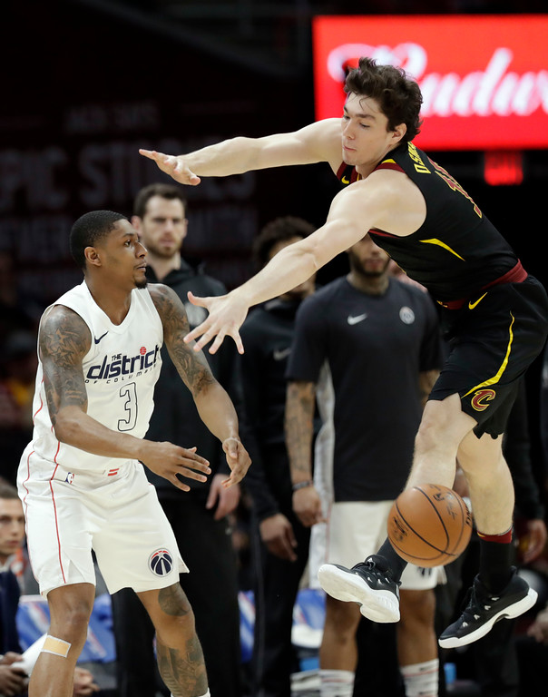 . Washington Wizards\' Bradley Beal (3) passes against Cleveland Cavaliers\' Cedi Osman, right, from Turkey, in the first half of an NBA basketball game, Thursday, April 5, 2018, in Cleveland. (AP Photo/Tony Dejak)