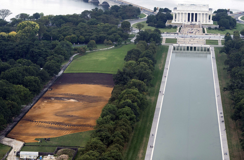 """. The landscape portrait, \""""Out of Many, One\"""" by Cuban American artist Jorge Rodriguez-Gerada, appears on the National Mall in Washington, DC, October 1, 2014, as viewed from the Washington Monument. SAUL LOEB/AFP/Getty Images"""
