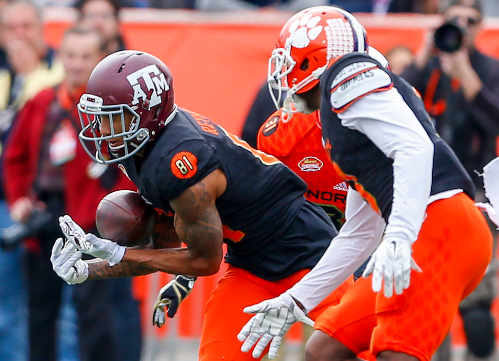 . South squad wide receiver Josh Reynolds of Texas A&M (81) catches a pass as during the first half of the Senior Bowl NCAA college football game, Saturday, Jan. 28, 2017, at Ladd-Peebles Stadium in Mobile, Ala. (AP Photo/Butch Dill)