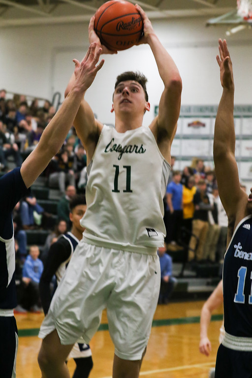 . 2018 - Basketball - Benedictine at Lake Catholic.  Benedictine defeated Lake Catholic 63-56.  Lake Catholic\'s Luka Eller (11) goes in for a layup.