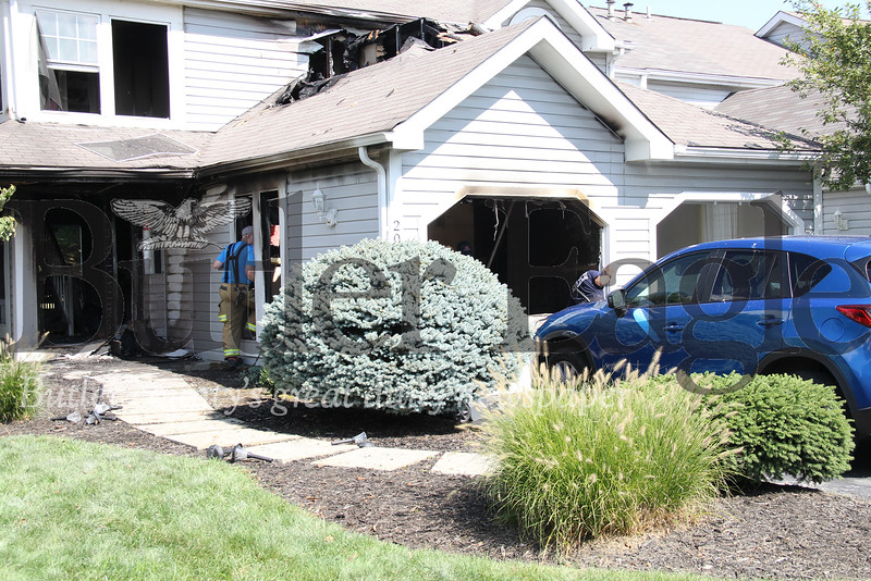 A member of Cranberry VFC looks into the home on 200 Clearbrook Road, Cranberry Township, that caught fire on Sunday morning, Sept. 2, 2018 Eric Jankiewicz/Butler Eagle