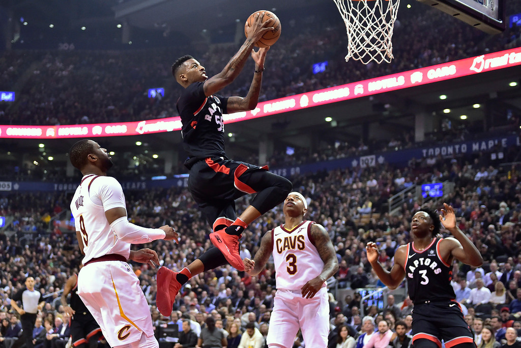 . Toronto Raptors guard Delon Wright (55) goes up for a basket past Cleveland Cavaliers guard Dwyane Wade (9) and guard Isaiah Thomas (3) as Raptors forward OG Anunoby (3) watches during the first half of an NBA basketball game Thursday, Jan. 11, 2018, in Toronto. (Frank Gunn/The Canadian Press via AP)