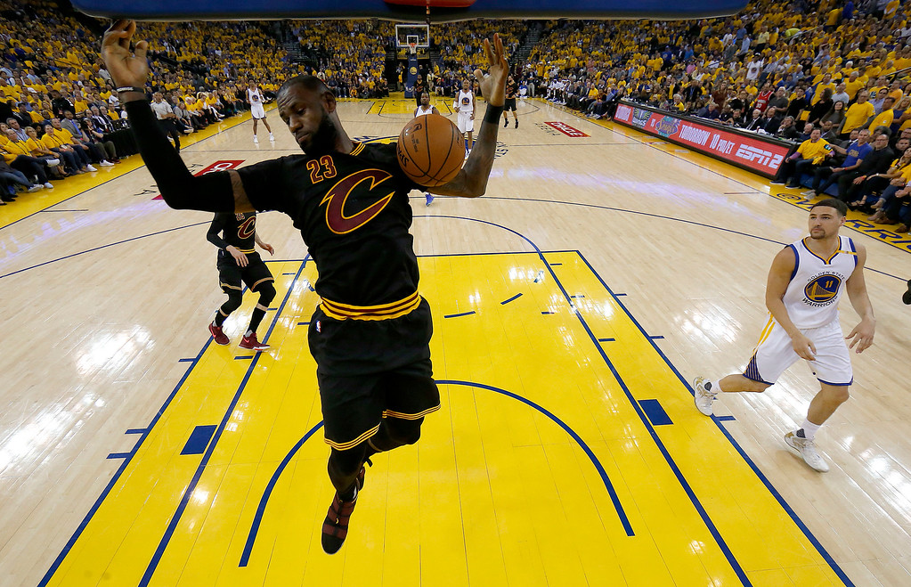 . Cleveland Cavaliers forward LeBron James (23) dunks against the Golden State Warriors during the first half of Game 5 of basketball\'s NBA Finals in Oakland, Calif., Monday, June 12, 2017. (AP Photo/Marcio Jose Sanchez, Pool)