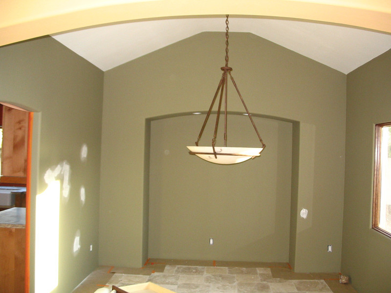 Dining room; ceiling fixture hung, but floor needing to be finished.