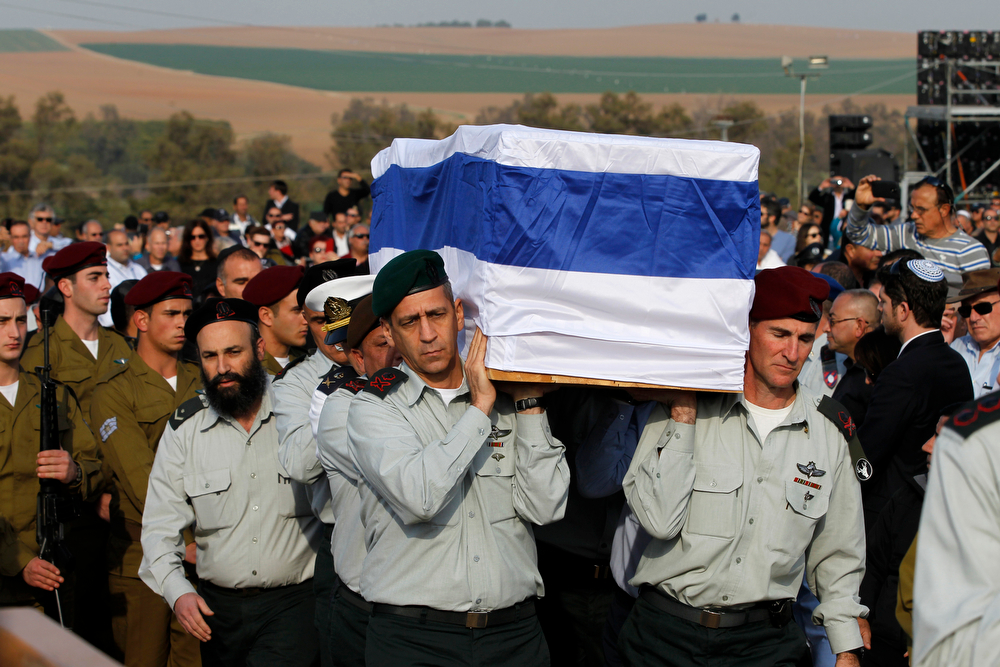 . Israeli army officers carry the coffin of former Israeli Prime Minister Ariel Sharon during his funeral near Sycamore Farm, Sharon\'s residence in southern Israel, Monday, Jan. 13, 2014. (AP Photo/Baz Ratner, Pool)