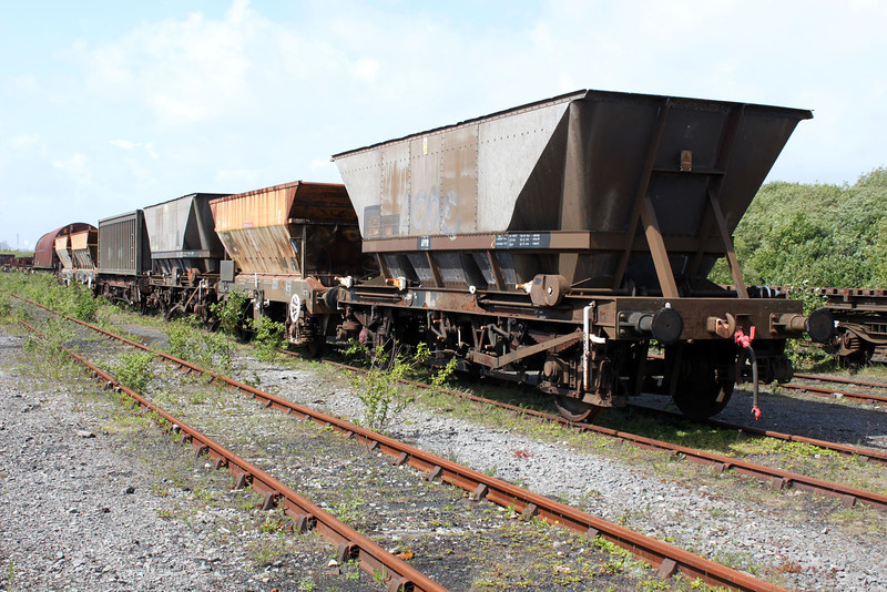 HMA 357064 Heads a line of stored wagons in Margam Engineers Yard 22/05/11